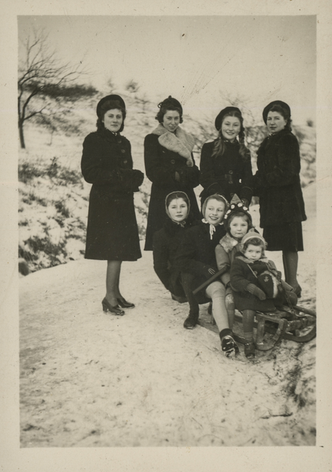 Women and children with sledges, 40s