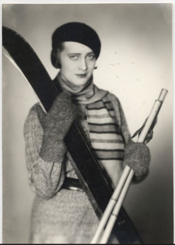 Portrait of woman with skiis